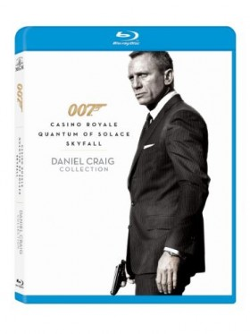 Daniel Craig standing and holding gun on a white background.